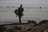 the pensive, pre-surf walk down the beach.